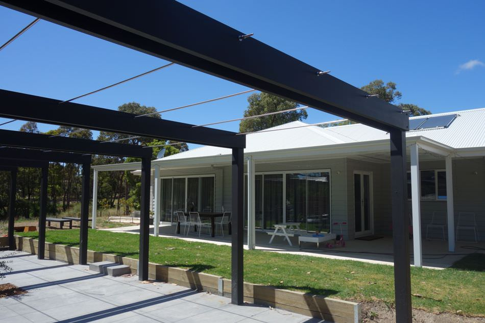 Portal framed pergola with tensioned cables inside ss rods