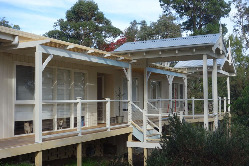 View shows central gable verandah over stair, with larger verandah & deck beyond