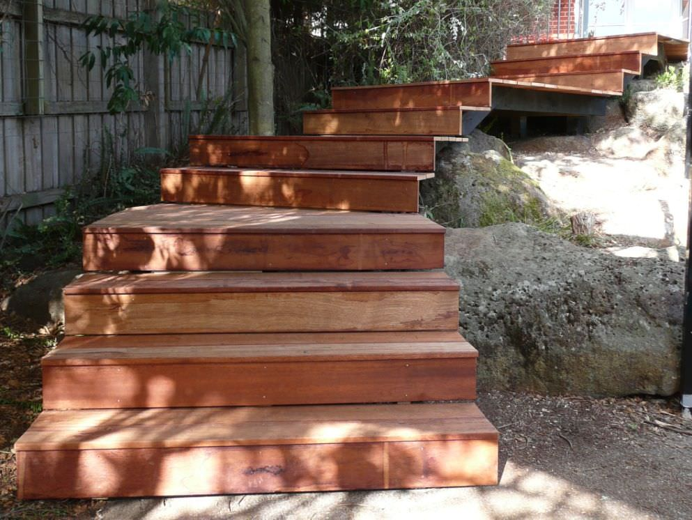 Timber decking used to create stepped, floating garden walkway
